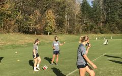 Women's Soccer Coach Heather Davis and team practice on the soccer fields.