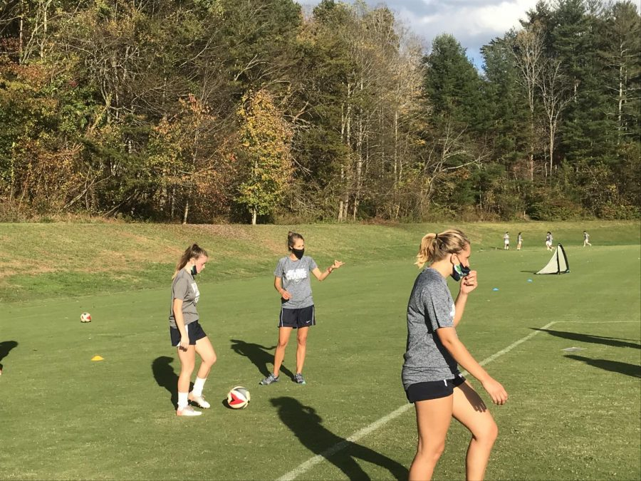 Women%27s+Soccer+Coach+Heather+Davis+and+team+practice+on+the+soccer+fields.+