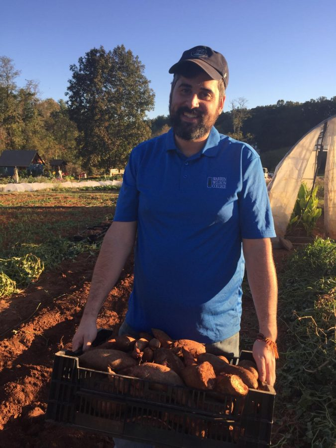 Professor Matt Hoffman volunteering at Root Cause Farm.