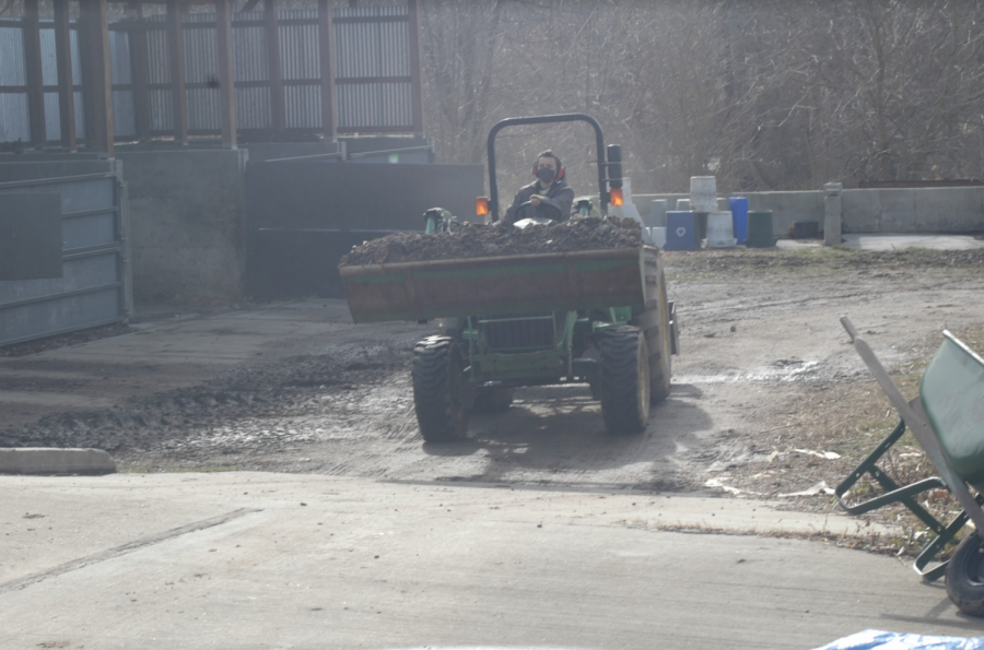Student Audrey Mader is Pictured Operating a tractor at the Recycling Center