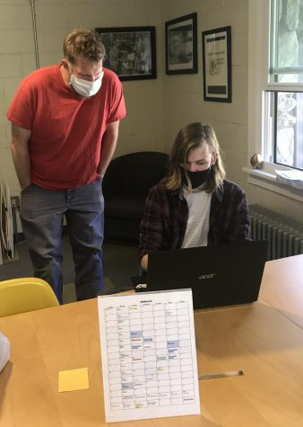 Associate Dean of Work Paul Bobbitt collaborates with Matthew Tkach, a student on the Work Program crew.